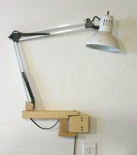 Swing arm lamp extenders