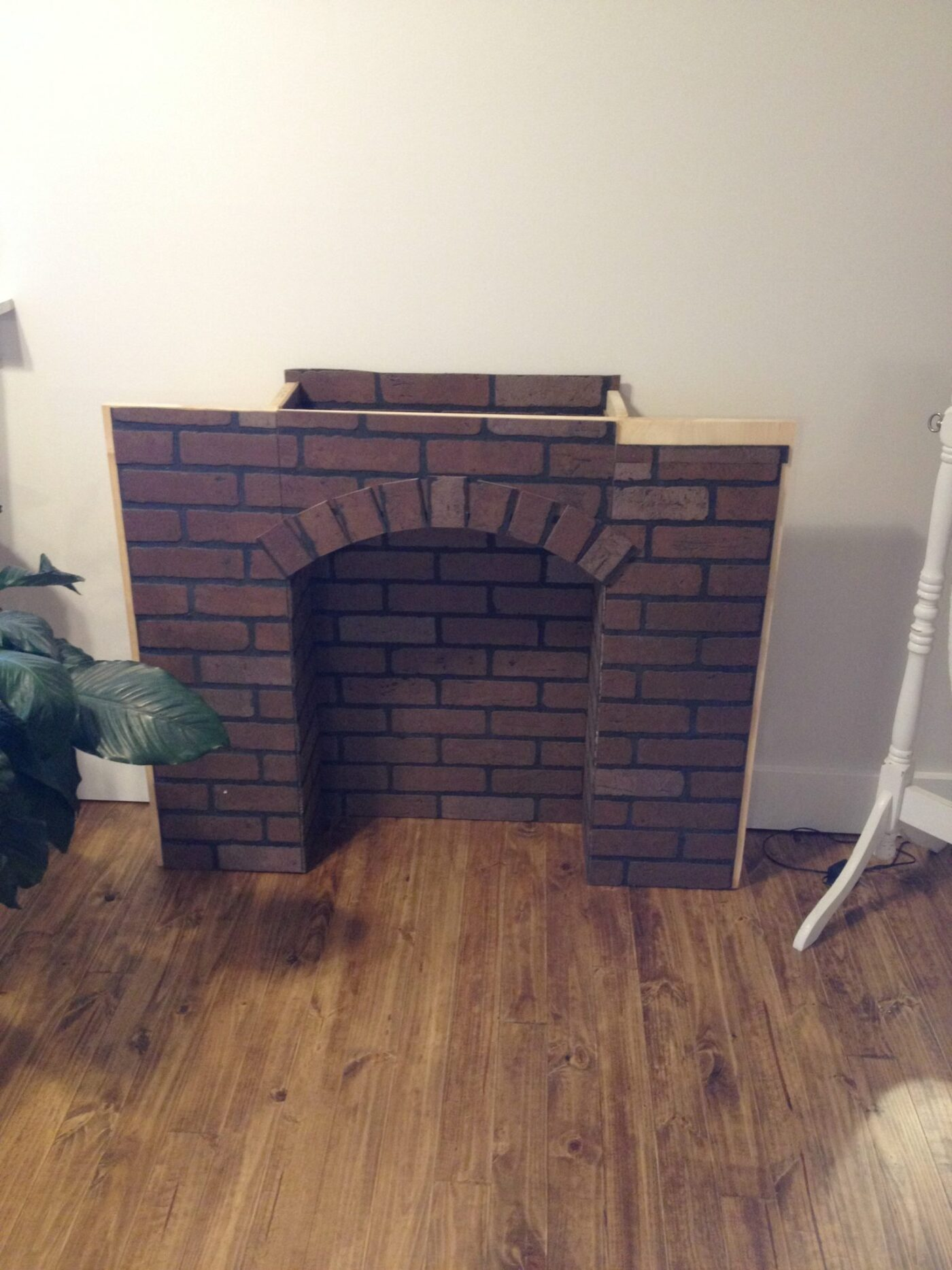 Build Your Own Fireplace Insert If You Re Going To Make It You Better Fake It Diy Fake Brick