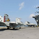 X-47B drone share the deck with F A-18 aircraft