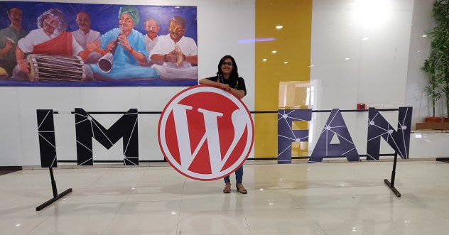 "Pooja standing in a banner ""I'm a WordPress fan"""