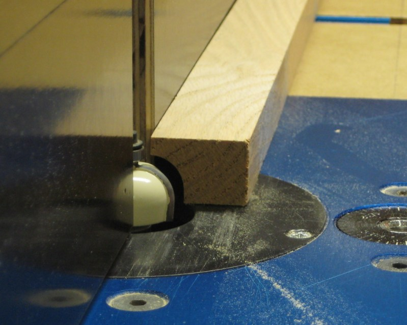 Using a cove bit to create a hollow in the wheel cut-off  jig