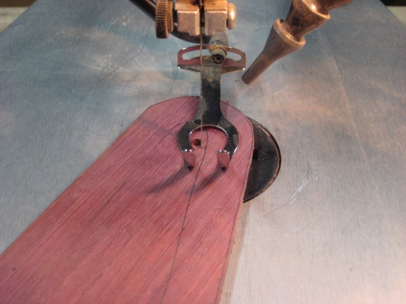 Cutting one of the car body parts out of the purple heartwood