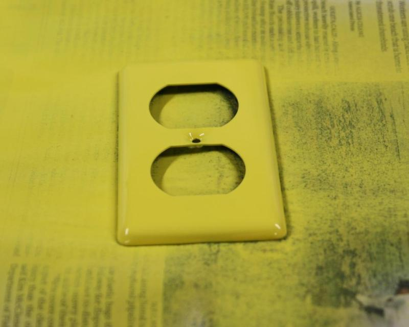 Spray painting the yellow outlets