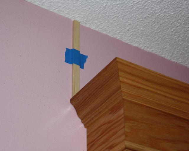 13 - I taped spacers to the wall to make sure the valances were in the right poistion