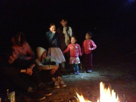 Mongolian children singing at the campfire.