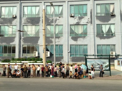North Koreans waiting for the bus