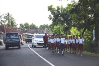 For some reason, school children marched in the roads blocking traffic.