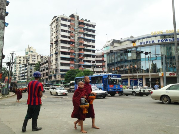 Lots of monks walking around in the middle of the city