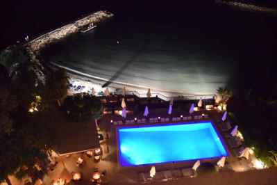 View of pool and beach at night