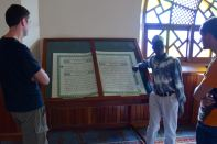Our guide reading a passage from the Koran