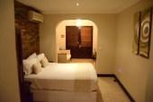 omali-lodge-room-bed