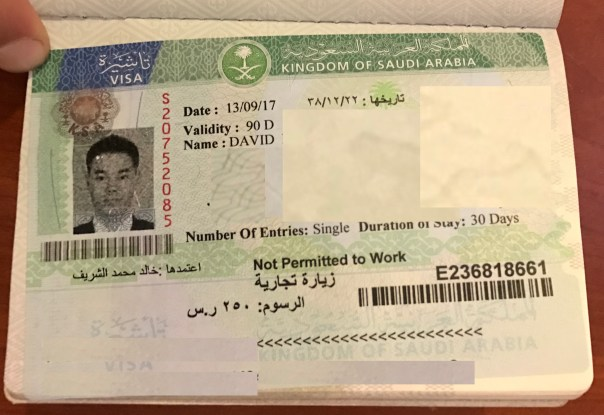 Happy with my visa in hand. Note: Poorly photoshopped the info out.