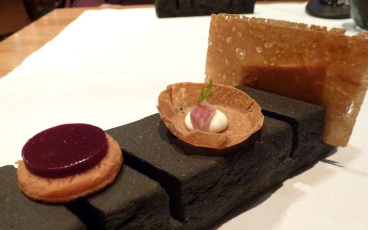 Canapés: Foie gras, smoked eel tart, morello jelly at hedone