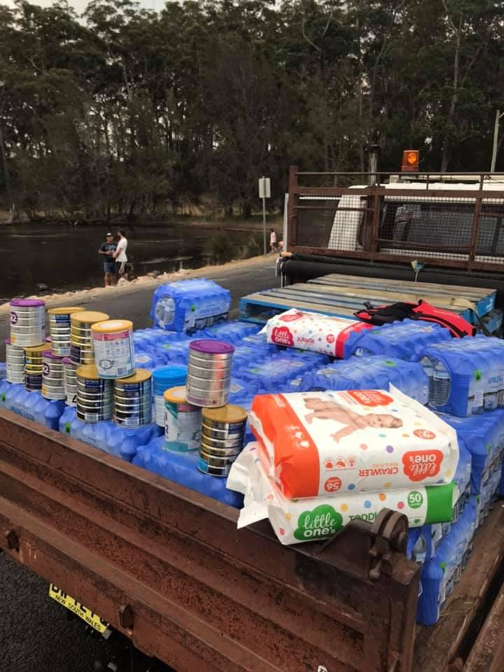 A Woolworths manager helped Shoalhaven locals load up a ute with water and baby supplies.