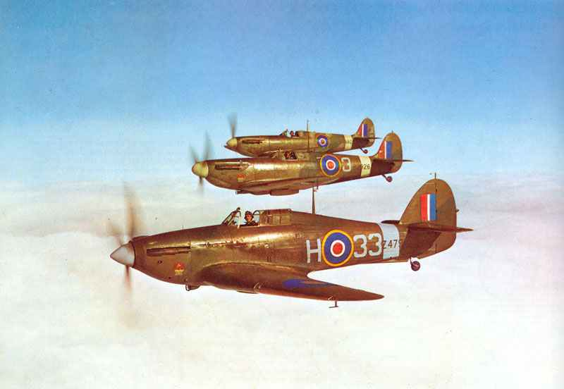Hurricane I in formation with two Spitfires