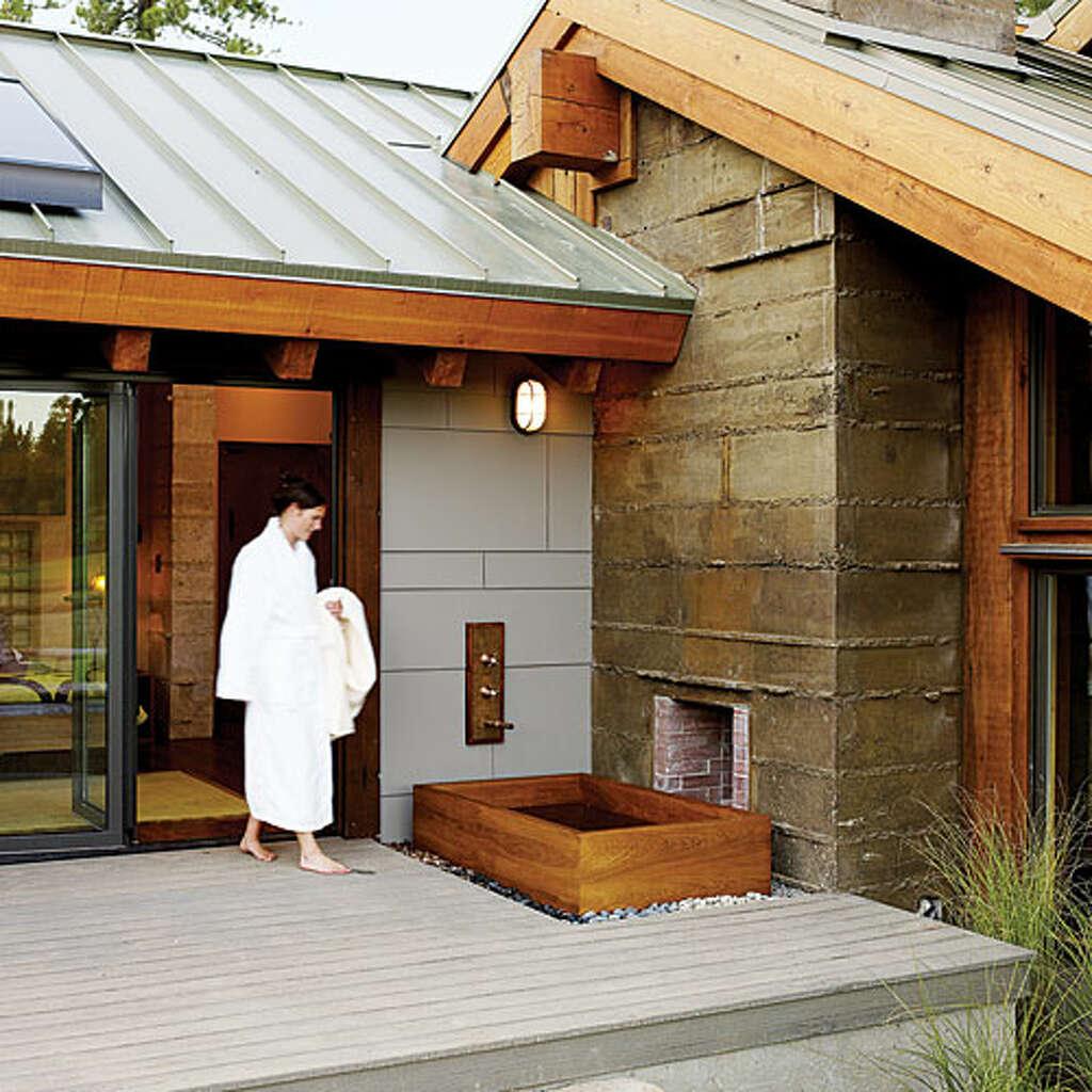 A deck with a tub a japanese ofuro soaking tub turns an evergrain deck