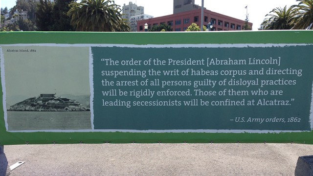 Photo of banner displaying Alcatraz-Lincoln quote on suspension of Habeas Corpus from Alcatraz Cruises terminal