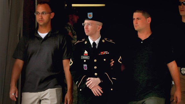 Army Pfc. Bradley Manning is escorted by military police as he leaves the first day of closing arguments in his military trial July 25, 2013, in Fort Meade, Md. (Chip Somodevilla/Getty Images)