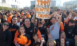 A Giants fan holds a sign.