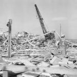 Workmen searched through the debris of what was the carpenter shop on the pier at Port in Chicago, Calif. on July 18, 1944. AP Photo