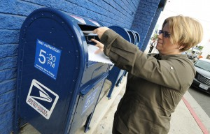 A woman rushes to mail her tax returns
