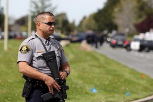 Police secure the scene at Oikos University after a shooting that killed seven people. (Jed Jacobsohn/Getty Images)