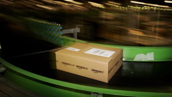 An Amazon parcel passes along a conveyor belt. (Bruno Vincent/Getty Images)
