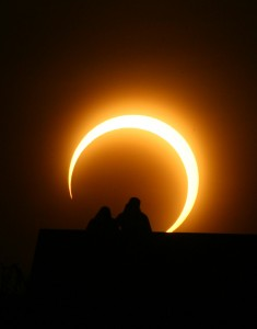 A Chinese couple watches an annular solar eclipse over Zhengzhou. (STR/AFP/Getty Images)