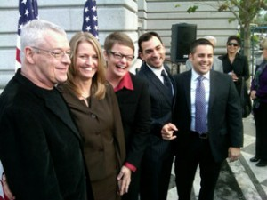Couples challenging Prop 8 pose before an Appeals Court hearing in Dec. 2010. (Scott Shafer/KQED)
