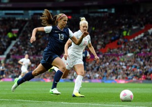 US forward Alex Morgan (L) and Canada's defender Lauren Sesselman compete during the London 2012 Olympic women's football semifinal match between the US Canada at Old Trafford in Manchester, north-west England, on August 6, 2012. (Paul Ellis/AFP/Getty Images)