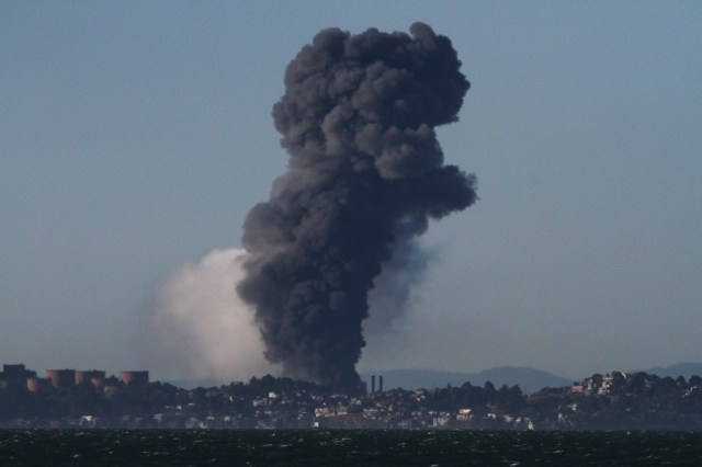 The U.S. Chemical Safety Board released this photo of a white vapor cloud obscured by smoke above the Chevron refinery in Richmond, which was on fire. Photo by Fototaker.net