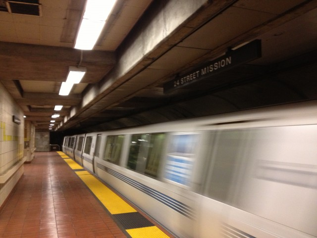An eastbound BART train departs San Francisco's 24th Street/Mission station.