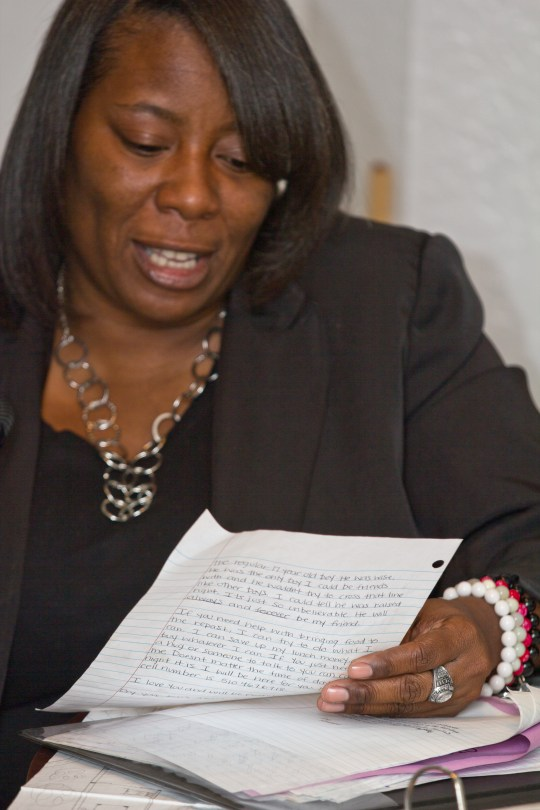 Brenda Grisham reads one of the many letters that she received after the murder of her son Christopher Jones, two years ago.  This letter was given to her by a friend of her sons.  Photo by Deborah Svoboda / KQED