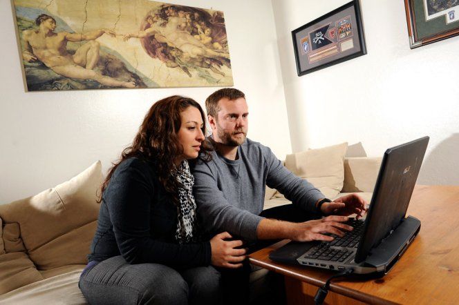 Army veteran Michael Grabski and his wife, Sandra, search real estate websites in their Napa apartment. The Department of Veterans Affairs expedited Grabski's 2-year-old claim for post-traumatic stress disorder and a knee injury after his case received media attention. (Michael Short/Center for Investigative Reporting)