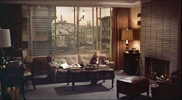 """The exterior scenes (for Scottie's home) were filmed at 900 Lombard Street on the corner of Jones ...  From inside the house, Hitchcock chose a window view of Coit Tower."""" (Courtesy Reel SF)"""