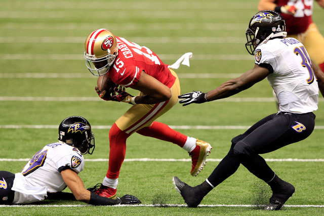 Michael Crabtree broke several tackles on his way to a 31-yard touchdown - photo by Jamie Squire/Getty Images.