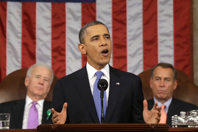 President Barack Obama, flanked by Vice President Joe Biden and House Speaker John Boehner, gives the 2013 State of the Union address. (Charles Dharapak-Pool/Getty Images)