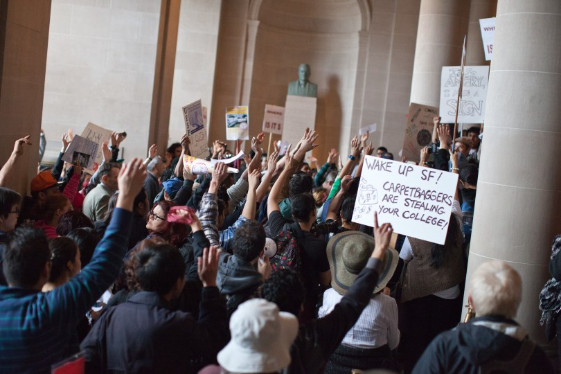 Hundreds of protesters marched into City Hall to demand