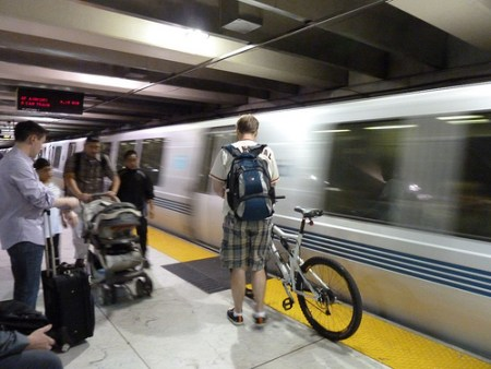 "A bicyclist during the first ""bikes on BART"" trial program on Aug. 10, 2012. (Courtesy of sfbike/Flickr)"