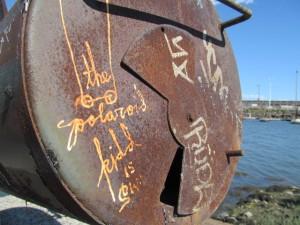 """""""The Polaroid Kidd"""" makes his mark at Oakland's 5th Avenue Marina."""