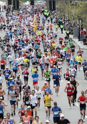 Participants run down Boylston Street toward the finish line during the 114th Boston Marathon on April 19, 2010 in Boston, Massachusetts. (Photo by Jim Rogash/Getty Images)