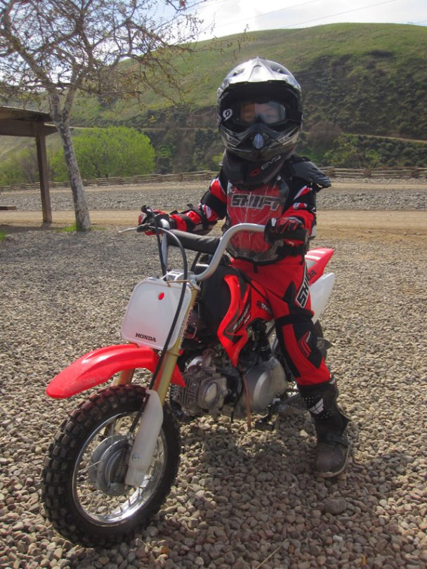 Family fun - or environmental threat on wheels? Jun Bato's 5-year-old son is one of many  children you'll spot on the trails of Carnegie SVRA. (KQED/Rachael Myrow)