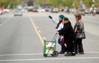 Seniors cross Alum Rock Avenue near the Eastside Neighborhood Center in San Jose.(Noah Berger/Center for Investigative Reporting)