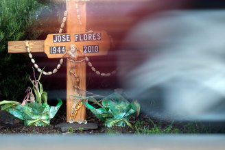 A wooden cross at the intersection of Clayton Road and Barbis Way in Concord memorializes the death of Jose Flores Miguel. (Adithya Sambamurthy/Center for Investigative Reporting)