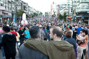 """Prop. 8 news captured the world's attention yesterday. Crowds filled the streets in the Castro  Wednesday night. (Chris Radcliff, 47, right, embraces Paul Catasus, 49 among the thousands of people that gathered in the Castro district of San Francisco to celebrate the Supreme Court's rulings on Prop 8 and DOMA. Radcliff and Catasus are both from San Francisco and plan to get married as soon as it's legal. """"We never even thought about actually getting married because it wasn't even an option until about a month ago,"""" Radcliff said. (Darlene Bouchard/KQED)"""