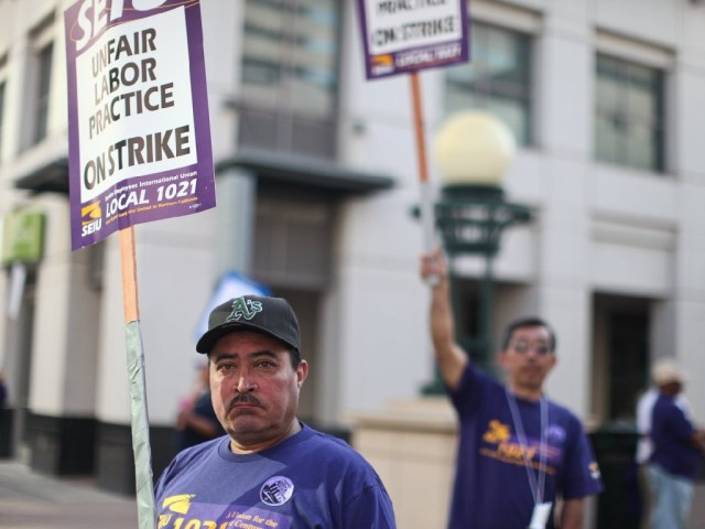 City of Oakland workers and BART employees form in groups around Frank Ogawa Plaza during the strike earlier this month. Photo by Deborah Svoboda/KQED