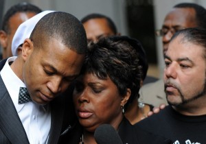 Wanda Johnson, the mother of Oscar J. Grant III, is comforted by her supporters outside the Los Angeles Superior Court after the involuntary manslaughter verdict against Johannes Mehserle (MARK RALSTON/AFP/Getty Images)