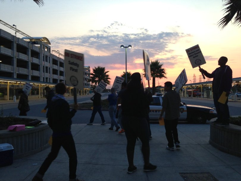 Picketers at Millbrae Station (Francesca Segre/KQED)