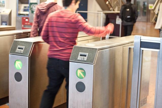 BART passenger enters fare gates.