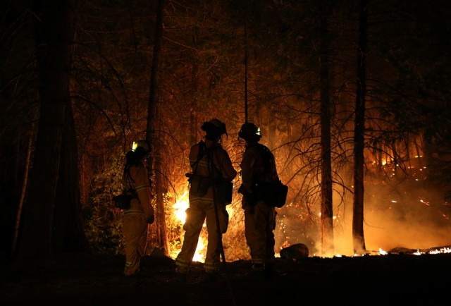 Fire crews near Groveland, a community west of Yosemite National Park. (Justin Sullivan/Getty Images)